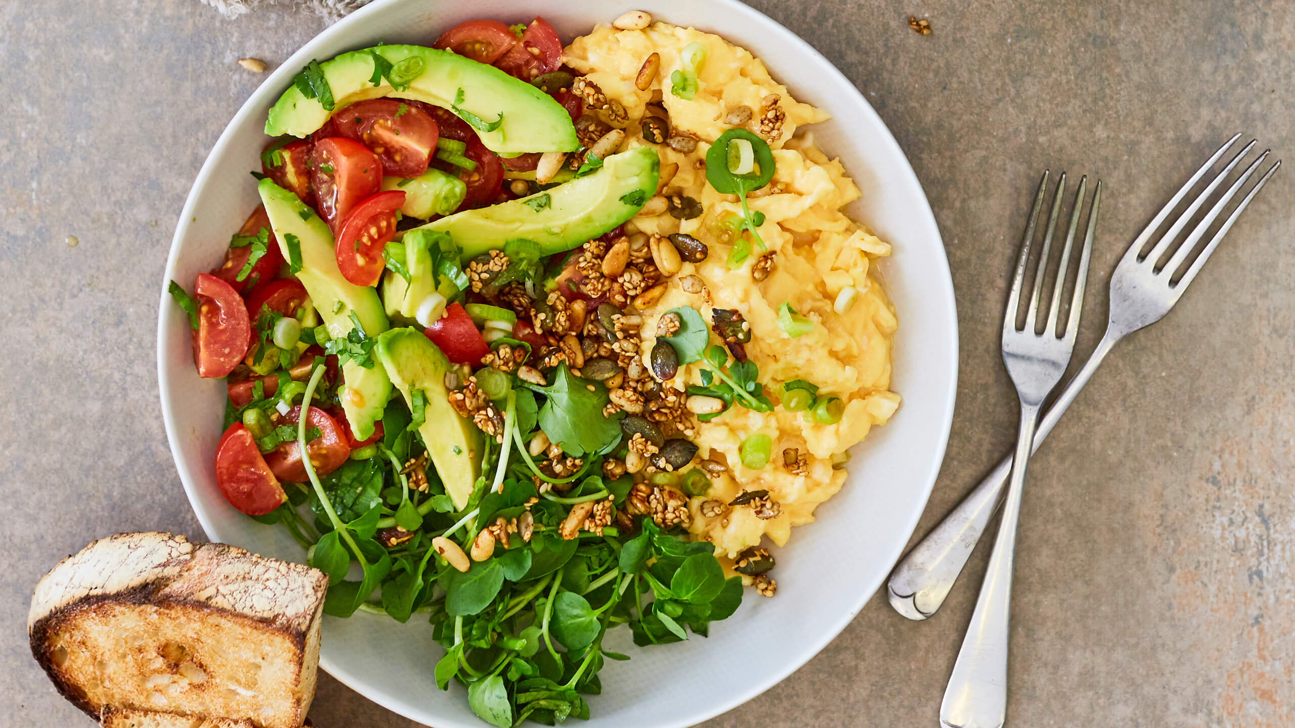 Avocado and Scrambled Egg Brunch Bowl with Sweet and Spicy Seeds