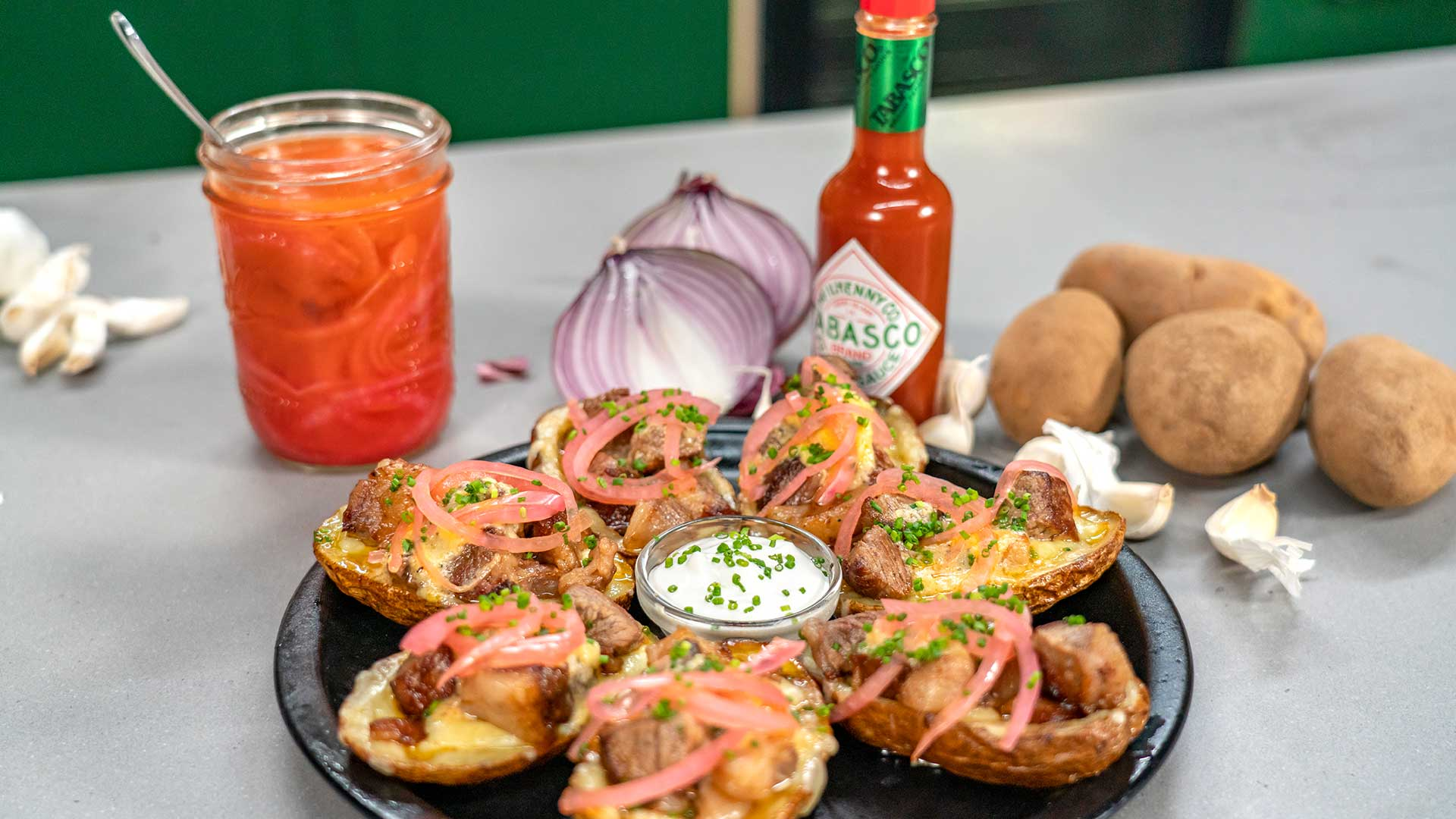 Steak & Cheese Potato Skins with Roasted Garlic and TABASCO® Sauce Compound Butter